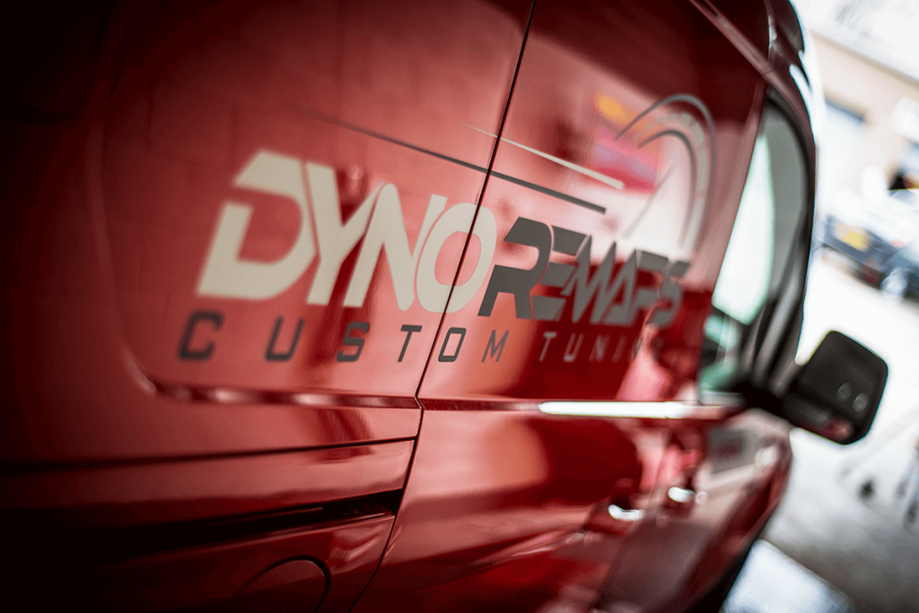 Side of Red Dyno Remaps Van