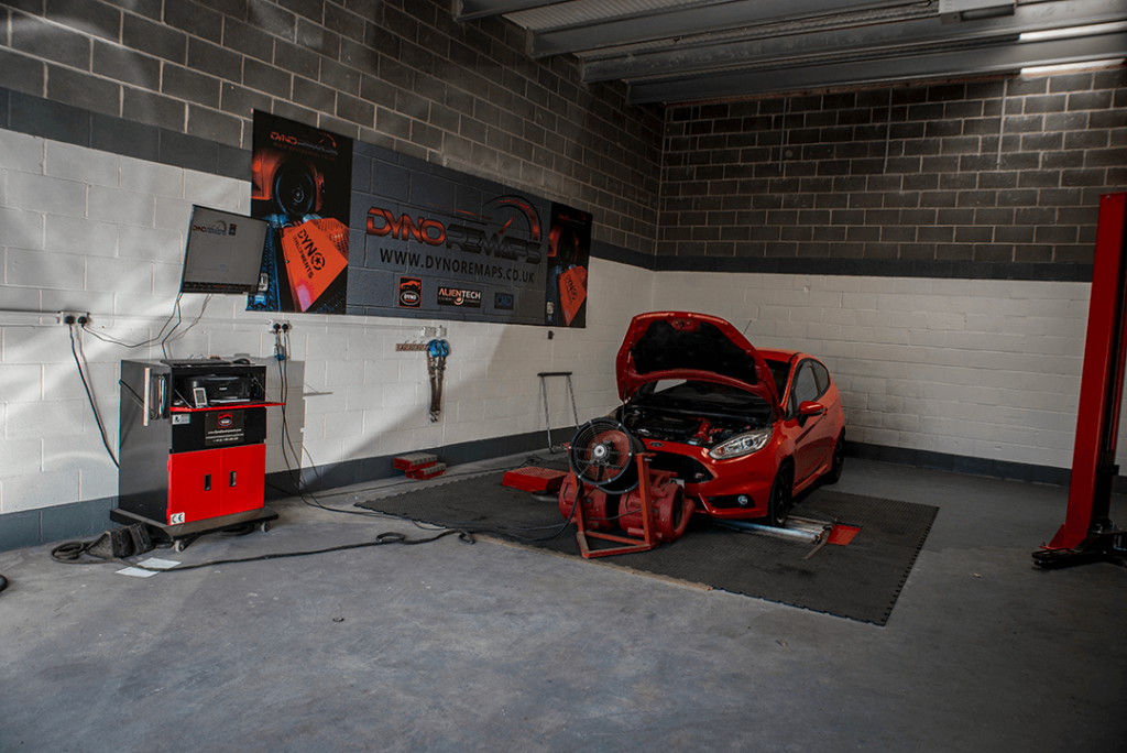 Red Car with Bonnet Upright in Dyno Workshop